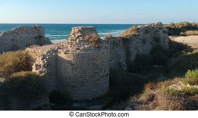 Drone over medieval coastal fort archaeological site shot...