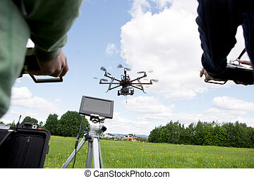 Drone Photography - Octocopter being operated by a...