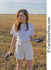Drone pilot woman. Professional UAV operator in the agricultural field.