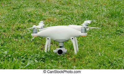 Drone preparing for flight outdoors on grass - Drone...