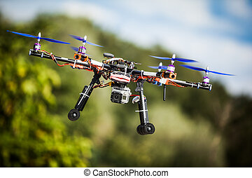 Drone - Professional carbon drone with GPS making a ride.