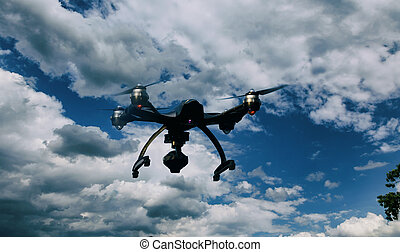Drone quadrocopter with camera flying over forest