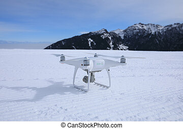 drone ready for flying on winter mountain top