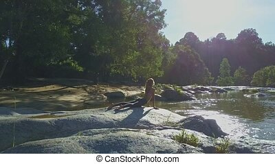 Drone Removes from Girl Lying in Yoga Pose on Smooth Boulder...
