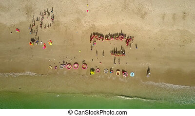 drone removes up from beach with preschool chidren - drone...