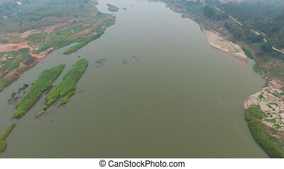 Drone shot of a wide river - An aerial shot of a land with...