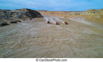 Drone shot of cars in a desert gully - An arial shot of...