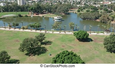 Drone shot of Ramat Gan National Israeli park with trees and...