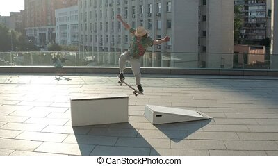 Drone shot of skater speeding up for extreme trick - Aerial...