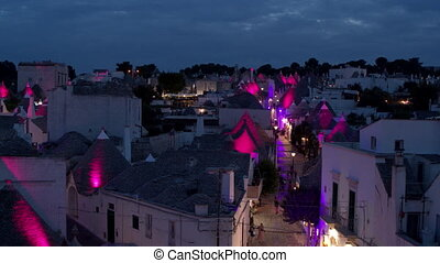 Vivid lights in the small town of Alberobello, Italy - Drone...