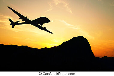 Drone silhouette - Drone flying over mountains on sunset ...