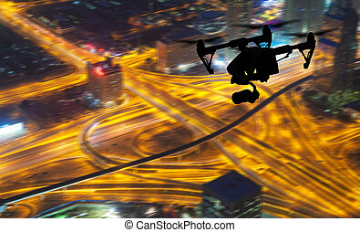 Drone silhouette flying above Dubaicity panorama - Drone ...
