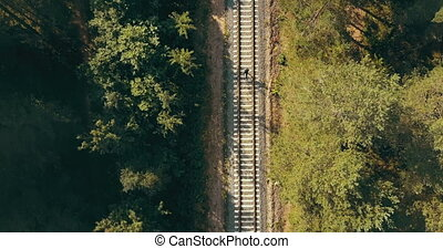 Drone top view of man running on train track. Concept of...