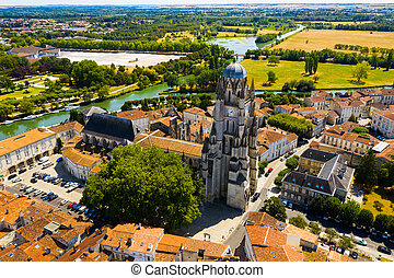 Scenic view from drone of historic district of Saintes town overlooking Flamboyant Gothic cathedral of St. Peter in summer, France