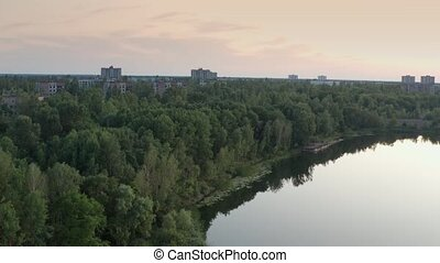 Drone view of Pripyat ghost town and river - Aerial view of...