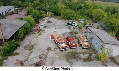 Drone view of rescue vehicles in motor depot - Aerial view...