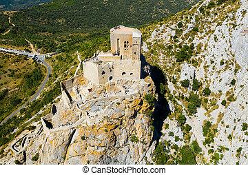 Drone view of ruins of Castle de Queribus on stone peak, France