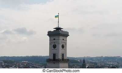Drone view of the large clock on the tower of the main city hall. Life in the modern city
