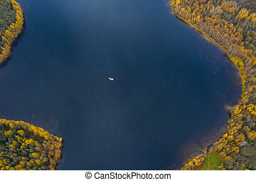 Drone view point of Wooden boat bath on a lake, water area in Autumn with lake Boroye, Valday national park, Russia, panoramic image, golden trees, Wooden lodges, cloudy weather