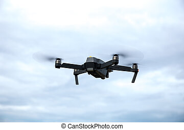 Drone with camera in blue sky