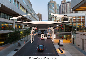 Drone with digital camera flying in a city