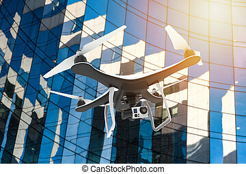 Drone with digital camera flying in front of a modern palace