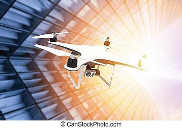 Drone with digital camera flying in the sunset of a modern city