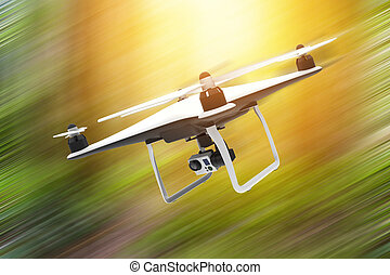 Drone with digital camera flying on a natural background