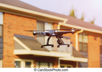 drone with professional cinema camera flying over a park in fall colors under light with deep long shadows