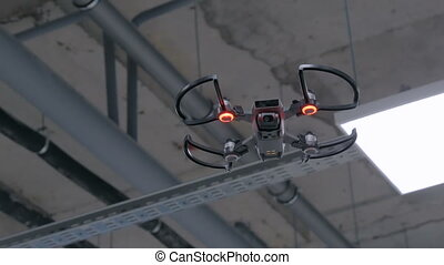 Drone with red light flying indoor