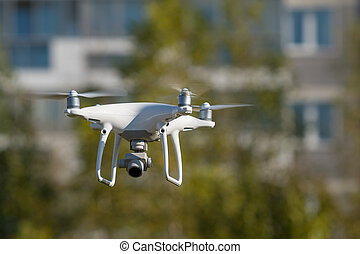 drone with video and photo camera for aerial photography outdoors with selective focus effect