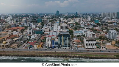 Drone zooming out above Colombo, Sri Lanka panorama. Aerial...
