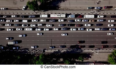 Drone's Eye View - Aerial top down view of city traffic jam...