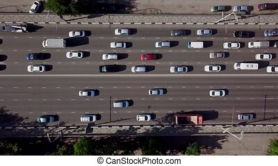 Drone's Eye View - Aerial top down view of urban traffic jam...