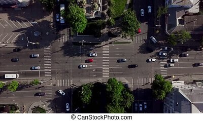 Aerial top down shot of a traffic jam on a car road intersection in the rush hour.