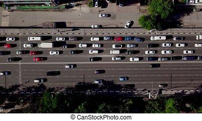 Drone's Eye View - Top down view of urban traffic jam -...