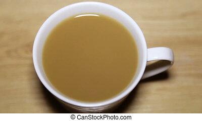 Drop a drop of cappuccino into a cup - A drop of cappuccino...