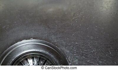 Drop drop in the kitchen sink - Broken faucet. Water drips...