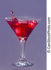 Drop of water falling in martini glass