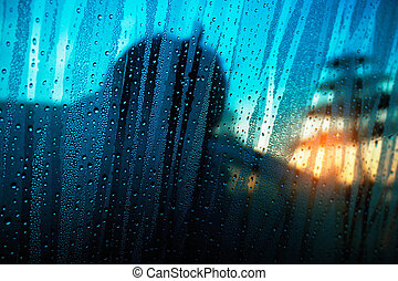 Droplets of mist on the glass.
