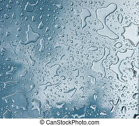 Droplets - Raindrops on glass, blue background