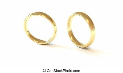 Dropped wedding rings isolated on the white. Slow motion
