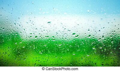 Drops of rain on window. Time lapse. - Drops of rain on...
