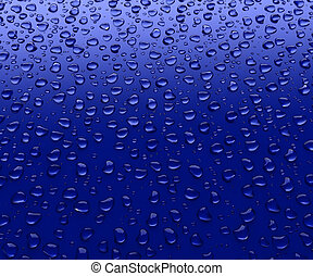 Drops of water on a blue background