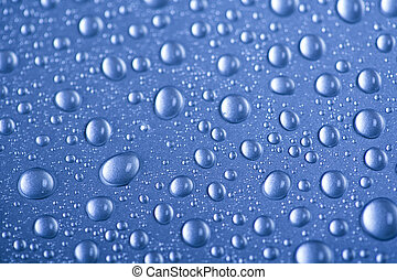 Drops of water on blue background