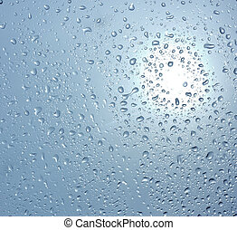 Drops of water on the glass on a colored background