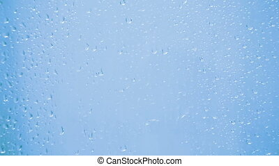 drops on glass - blue background