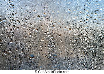Drops on glass. Close-up background