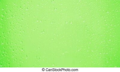 drops on glass - green background