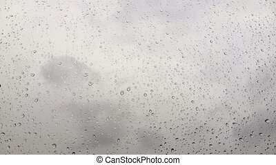 Drops on the glass in cloudy weather